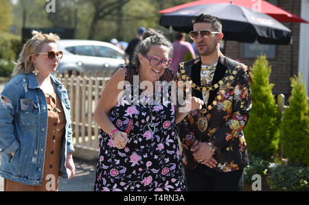 Crawley Sussex, UK. 19th Apr, 2019. Spectators enjoy the sunshine at the World Marbles Championship held at The Greyhound pub at Tinsley Green near Crawley in Sussex . The annual event has been held on Good Friday every year since the 1930s and is open to players from around the world Credit: Simon Dack/Alamy Live News - Stock Image