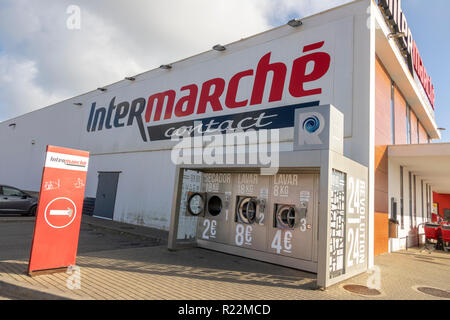 An Intermarche Supermarket With Outside Laundry Washing Machines For Campers In Sagres Portugal - Stock Image