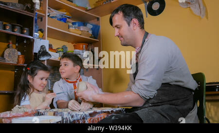 Family working with clay - Stock Image