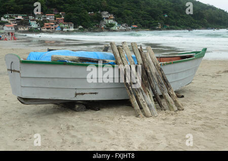 fishing boat with trunks in a fishers village in Florianopolis, Brazil - Stock Image