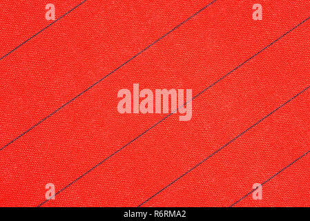 Abstract red fabric with black stripes texture background. Book cover - Stock Image