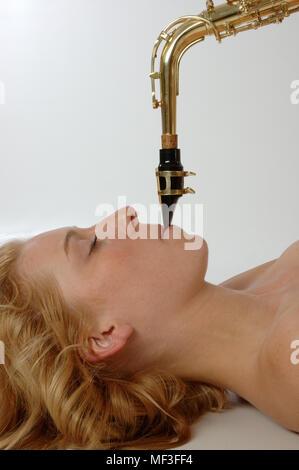Female Sax Player - Stock Image