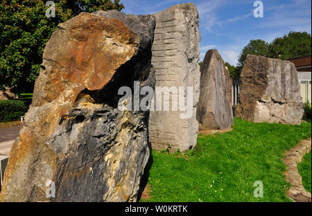 The ECOS standing stones in Frome, left Flinty Sandstone from the Netherlands, centre left  Portland limestone from UK and   centre right marble from - Stock Image
