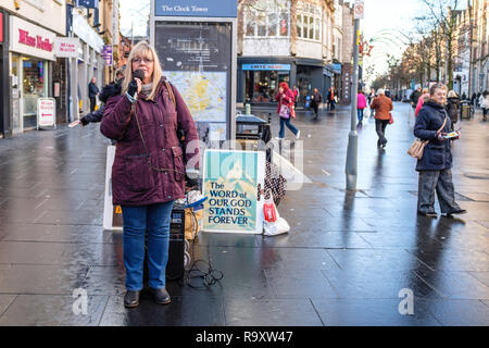 Speading the word of God in a city centre. - Stock Image