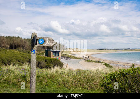 Coast footpath signpost on coastal path to Silver Bay lovely quiet sandy beach. Rhoscolyn, Isle of Anglesey, Wales, UK, Britain - Stock Image