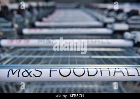 Trolleys from Marks & Spencer foodhall in a row outside supermarket in London, England - Stock Image