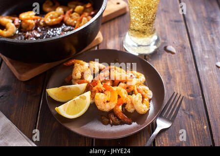 Fried shripms and glas of beer for dinner - Stock Image