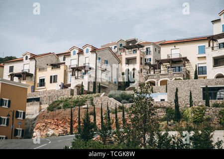 View of a modern residential area or district with many small residential houses. - Stock Image