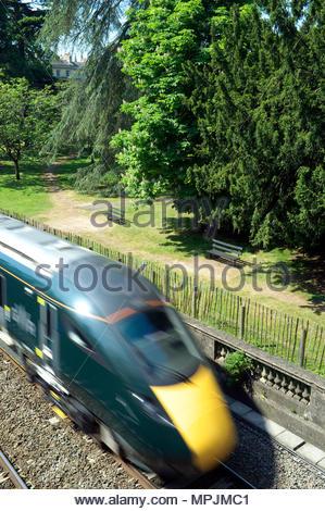 A GWR train passing thru Sydney Gardens in Bath, UK. - Stock Image