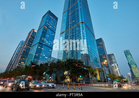 High-rise buildings in Futian Central Business District (CBD) illuminated at dusk. Shenzhen city, Guangdong Province, China. - Stock Image