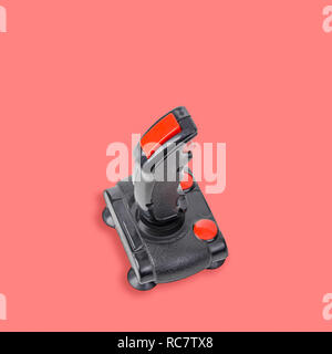 Retro computer gaming controller isolated on pink background. Color of the year 2019 - Living Coral - Stock Image