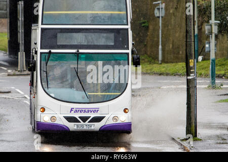 Chippenham, Wiltshire, UK. 12th Mar, 2019. A bus driver is pictured braving heavy rain in Chippenham as heavy rain showers make their way across the UK. Credit: lynchpics/Alamy Live News - Stock Image