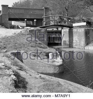 Basingstoke Canal Lock 25 of the Deepcut Locks near Pirbright, Surrey, UK just after restoration of the lock had - Stock Image