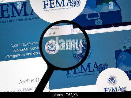 MONTREAL, CANADA - APRIL 24, 2019 : Fema.gov USA Government home page under magnifying glass. FEMA is The Federal Emergency Management Agency - Stock Image