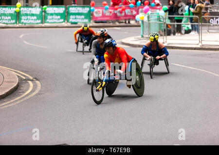 Zou Lihong from Chine competing in the Women's Elite Wheelchair race(T53/T54), during the 2019 London marathon, she went on to finish 6th in  a time of 01:52:10 - Stock Image
