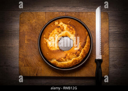 Maderia cake from above in round baking dish - Stock Image