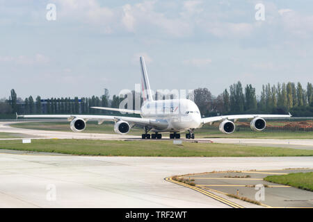 ORLY, FRANCE - APRIL 17 2019 :  Long range four engines Airbus A380 arrival on a taxiway, Air France company. - Stock Image