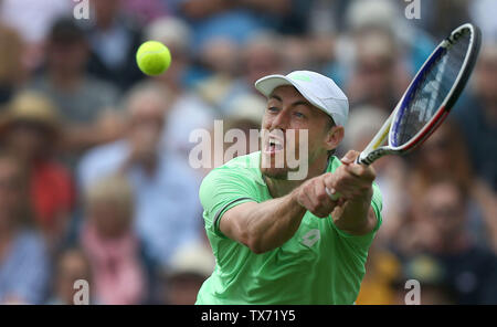 Eastbourne, UK. 24 June 2019 John Millman of Australia returns a serve from Fernando Verdasco of Spain on Day three of the Nature Valley International at Devonshire Park. Credit: James Boardman / Alamy Live News - Stock Image