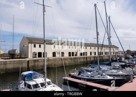 Pleasure boats and yachts moored in the harbour marina in coastal town. Lossiemouth, Moray, Scotland, UK, Britain - Stock Image