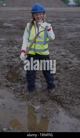 Katrina Hart gets to grips with the shovel during the ceremonial ground breaking of the Commonwealth Games 2022 Athletes Village, in Perry Barr, Birmingham - Stock Image