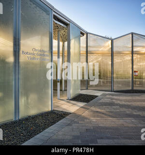 Part of the Visitor Centre and glasshouses of the Botanic Gardens in Christchurch, New Zealand, seen on a sunny winter morning. - Stock Image