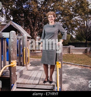 Middle-aged woman at playground - Stock Image