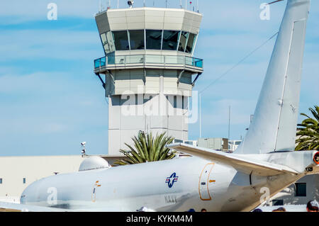 Navy E-6 Mercury  TACAMO Aircraft sits on the ramp of MCAS Miramar in view of the air traffic control tower. - Stock Image