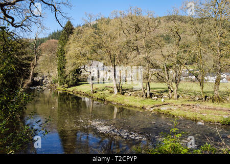 View up Afon Llugwy River flowing through Snowdonia village of Betws-y-Coed, Conwy, Wales, UK, Britain - Stock Image