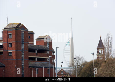 Emirates Spinnaker Tower in Portsmouth seen from afar, framed between buildings. - Stock Image