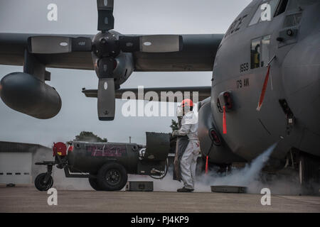 Senior Airman Brandon M. Acks, Crew Chief assigned to the 179th Airlift Wing Maintenance Group, refills the C-130H Hercules with liquid oxygen (LOX) August 30, 2018, at the 179th Airlift Wing, Mansfield, Ohio. The C-130H Hercules holds 24 liters of LOX and is used to ensure air crew have oxygen when flying at high altitudes. (U.S. Air National Guard photo by Airman Alexis Wade) - Stock Image