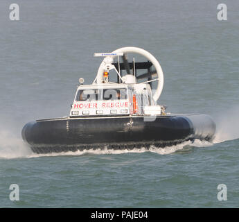 Changi-Airport Emergency Service brand-new Griffon Hoverwork 8000TD rescue hovercraft flying across the sea of the Straits of Singapore - Stock Image
