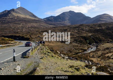 Allt Coire nam Bruadaram river as it crosses the A87 downstream of the Blackhill waterfall, Isle of Skye, Highland Region, Scotland, UK - Stock Image