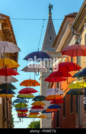 Umbrella Street in the coastal town of Novigrad on the Istria Peninsula in Croatia. - Stock Image