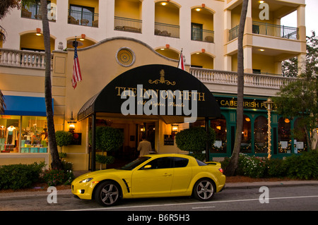 Inn on Fifth yellow sports car Old Naples Florida fl popular hotel with McCabes Irish Pub - Stock Image