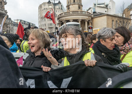 London, UK. 9th Dec, 2018. Protesters line up close to the BBC for the united counter demonstration by anti-fascists marches in opposition to Tommy Robinson's fascist pro-Brexit march. Author Louise Raw at left, Nita Sanghera of UCU at right. The march which included both remain and leave supporting anti-fascists gathered at the BBC to to to a rally at Downing St. Police had issued conditions on both events designed to keep the two groups well apart. Credit: Peter Marshall/Alamy Live News - Stock Image