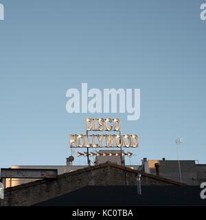 Direction sign to Disco Hollywood, Avenue vila de Tossa, LLoret de Mar, Spain - Stock Image