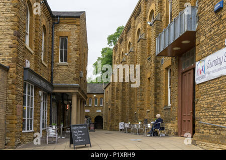 College Street Mews, an attractive thoroughfare between two historic buildings, Northampton, UK; now houses a café and some small shops. - Stock Image