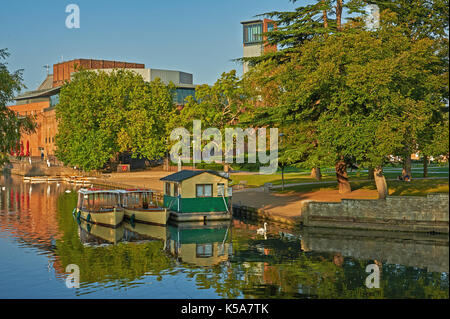 Stratford upon Avon and early morning autumn reflections on the River Avon with a view to the Royal Shakespeare Theatre. - Stock Image