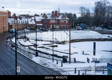 The Roman amphitheatre in Chester city centre covered with a light dusting of snow - Stock Image