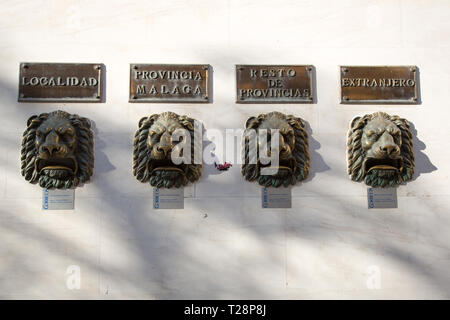 Regional letter boxes in the design of Lions heads on the outside wall of Fuengirola post office. - Stock Image