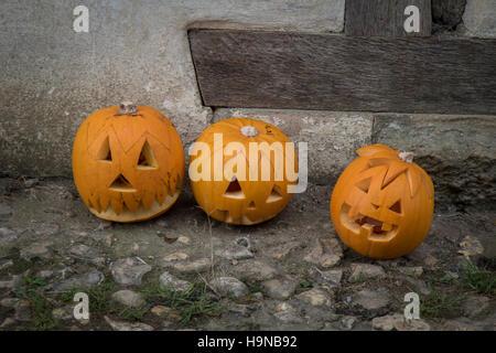 Carved pumpkins, celebrating Halloween - Stock Image
