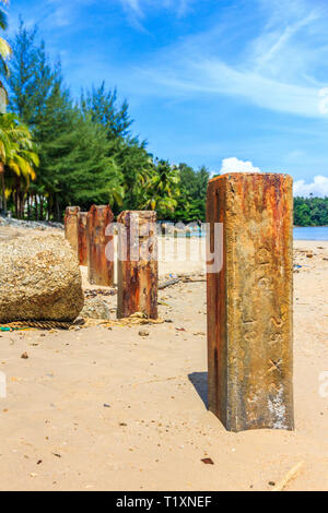 Concrete posts at the southern end of Bang Tao beach on Phuket, Thailand - Stock Image