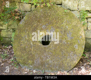 18th century millstone at Prudhoe castle watermill  Northumberland, England, UK - Stock Image