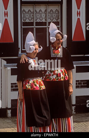 Small town of Volendam on the West coast of The Zuiderzee where many people wear traditional costume - Stock Image