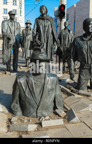 Wroclaw Poland sculpture, view of a set of sculptures (titled Passage, designed by Jerzy Kalina) sinking into a pavement in Wroclaw city center. - Stock Image