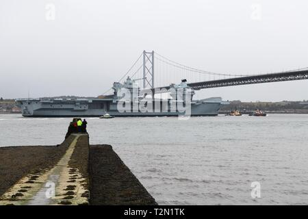 Queensferry, UK. 3rd Apr, 2019. UK, Europe. HMS Queen Elizabeth passes under the Forth Road Bridge on a visit to Rosyth dry dock for scheduled maintenance checks prior to full operational deployment in 2020. Credit: Douglas Carr/Alamy Live News - Stock Image