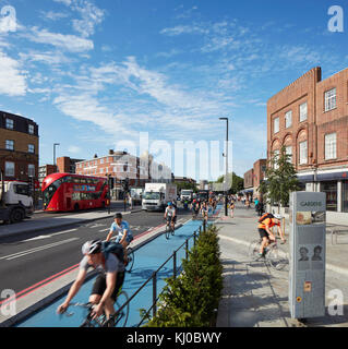 Intersection with new bicycle lane and morning traffic. Stockwell Framework Masterplan, London, United Kingdom. - Stock Image