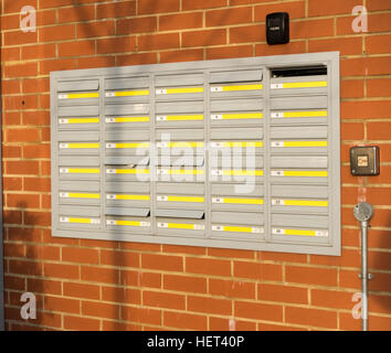 Multiple letterboxes outside a block of flats or apartments - Stock Image