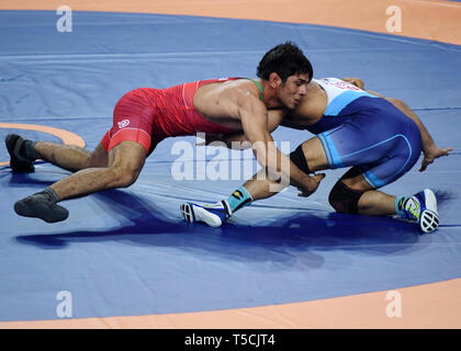 (190423) -- XI'AN, April 23, 2019 (Xinhua) -- Bahman Mohammad Teymouri(L) of Iran competes with Parveen Rana of India during the 79KG match at 2019 Asian Wrestling Championship in Xi'an, capital city of northwest China's Shaanxi Province on April 23, 2019. (Xinhua/Li Yibo) - Stock Image