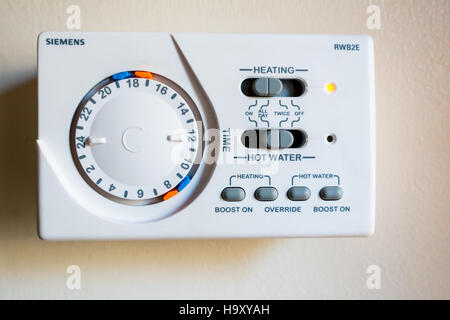 A Siemens RWB2E wall mounted mechanical central heating and hot water timer. - Stock Image